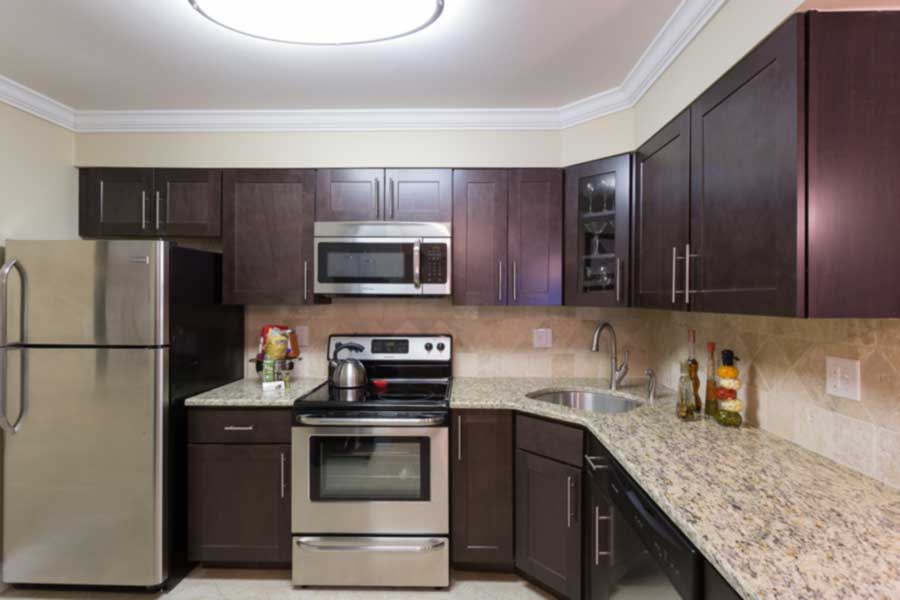 Kitchen with stainless steel appliances at Meadowbrook apartments in Huntingdon Valley.