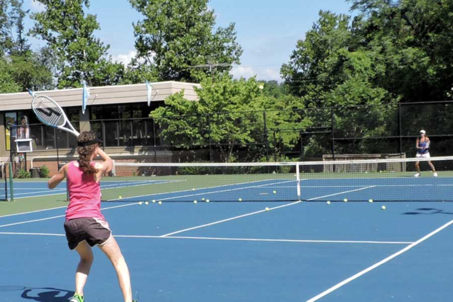 Residents playing tennis on property tennis courts